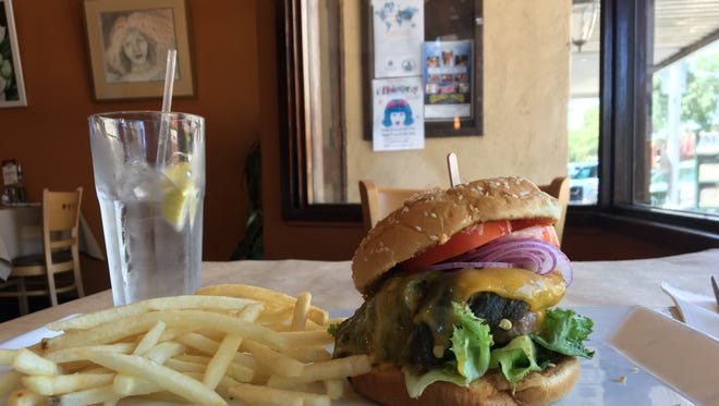 Cafe 225's Green Chili Burger is shown.