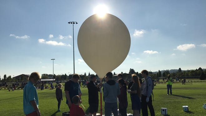 Silverton High School students and staff inflate their high-altitude balloon prior to launch on Aug. 21, 2017.