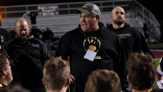 Tri-Valley coach Justin Buttermore talks to his team following a 13-9 win against Columbus Hartley in the Division III, Region 11 finals at Newark's White Field. The Scotties face unbeaten, top-ranked Trotwood-Madison on Saturday night in the state championship game.