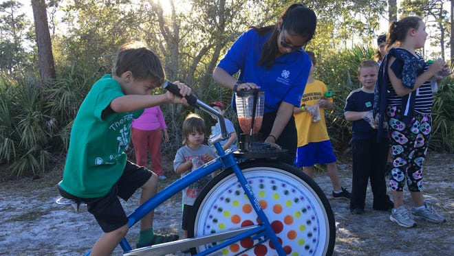 """A 4-H Virtual 5K event in Brevard County featured a """"smooth bike,"""" a stationary bike that powers a blender filled with healthy smoothie ingredients."""