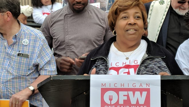 Alicia Renee Farris of Michigan One Fair Wage speaks outside the Michigan Secretary of State's office on May 21, 2018.