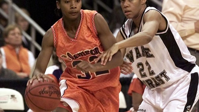 Chrissy Floyd, left, led Laurens High to state championships in 1998 and 1999 and was a four-time All-ACC selection at Clemson.