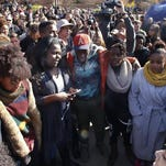 Supporters gather Nov. 9 after the announcement that University of Missouri System President Tim Wolfe would resign, in Columbia, Mo., over mounting pressure from campus groups regarding his handling of racial tensions at the school.