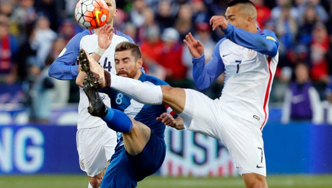 Guatemala's Jean Marquez, left, and United States' Bobby Wood fight for a loose ball during the first half of a World Cup qualifying soccer match Tuesday, March 29, 2016, in Columbus, Ohio. (AP Photo/Jay LaPrete)