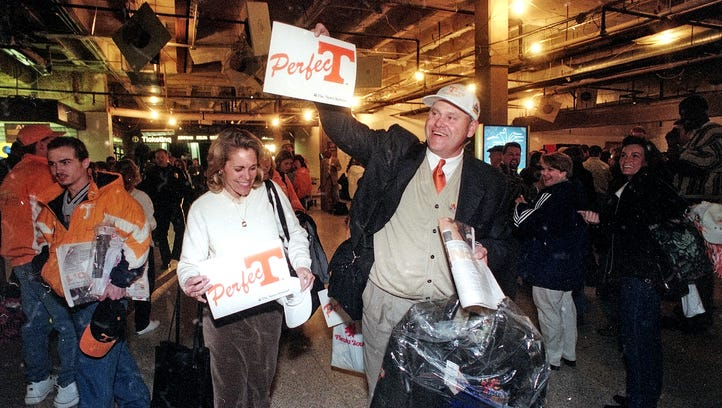 University of Tennessee football coach Phil Fulmer and his wife, Vicky, celebrate a perfect season after arriving from the Fiesta Bowl on Tuesday, Jan. 5, 1999, at McGhee Tyson Airport. Fulmer's Vols captured the NCAA championship with a 23-16 win over Florida State.