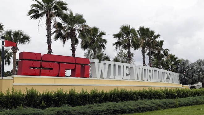 A sign marking the entrance to ESPN's Wide World of Sports at Walt Disney World is seen Wednesday, June 3, in Kissimmee, Fla. The NBA has told the National Basketball Players Association that it will present a 22-team plan for restarting the season at Disney.