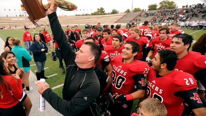 Anson head coach Chris Hagler celebrates with his players after the Tigers' 43-31 win in the Region I-2A Div. II regional semifinal on Saturday, Nov. 26, 2016, at the Mustang Bowl in Sweetwater.
