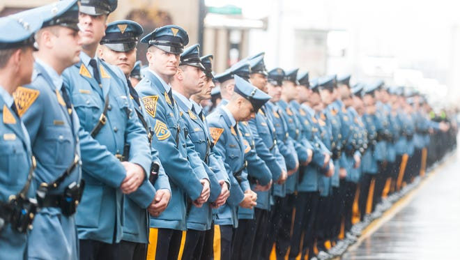 New Jersey State Troopers prepare to enter the funeral of fallen New Jersey State Trooper Frankie Williams held at Boardwalk Hall in Atlantic City on Monday, December 12.