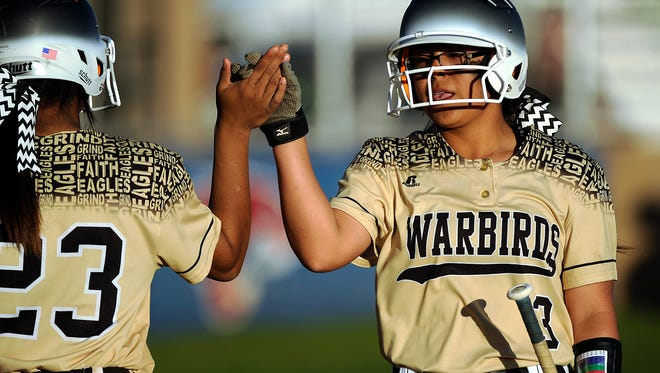 Abilene High's Natalia Davila (3) is congratulated by teammate Alyssa Washington (23) after scoring in the top of the third inning of the Lady Eagles' 13-1 win in the Abilene Icebreaker softball tournament on Friday, Feb. 24, 2017, at Cooper High School.
