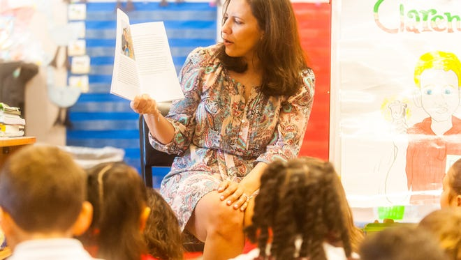 """Stephanie Baruffi reads her book """"Clarence"""" to Ms. Jessica Hyland's first grade class at Dr. William Mennies Elementary School on Monday, April 10."""