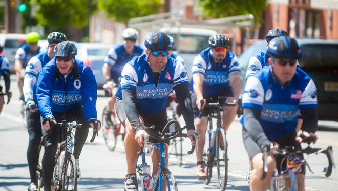 Members of the 2017 Police Unity Tour make their way to the Millville Police Station on Tuesday, May 9.