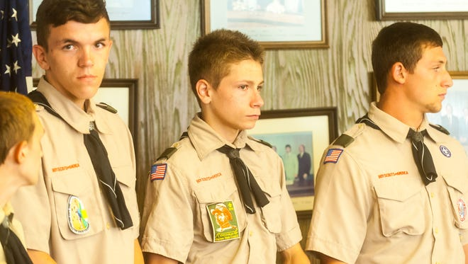 Boy Scout Troop 4 was honored Wednesday night by the Millville City Commission for volunteering for a long Saturday collecting trash.
