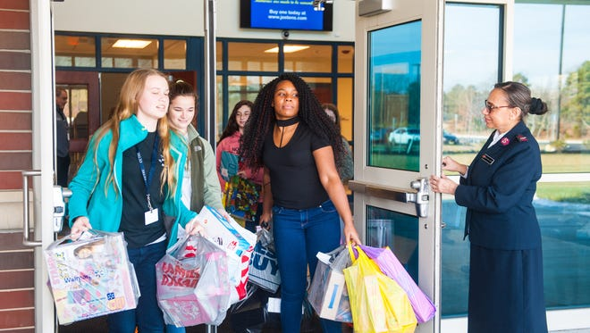 Cumberland County Technical High students exit the school with toys to be loaded into a Salvation Army van as part of a Toy Drive by the Interact Club at Cumberland County Tech on Monday, December 18.