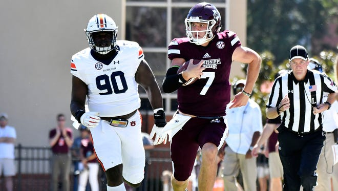 Oct 8, 2016; Starkville, MS, USA; Mississippi State Bulldogs quarterback Nick Fitzgerald (7) runs the ball during the third quarter of the game against the Auburn Tigers at Davis Wade Stadium. Auburn won 38-14.