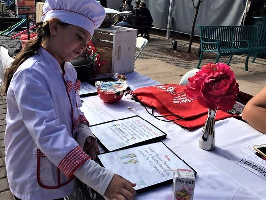 Chef Sophia explains her cooking lessons business,  Lovely Little Elves - In the Kitchen, during the Cruces Kids Can business fair on Saturday, Nov. 18, 2017,  on Plaza de Las Cruces.