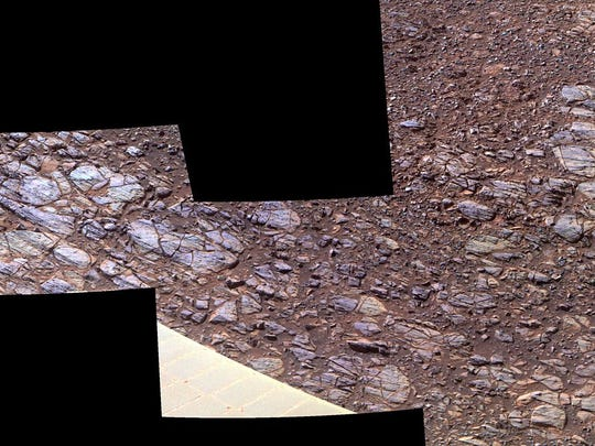 "This October 2017 photo shows an enhanced-color view of ground sloping downward to the right in ""Perseverance Valley,"" seen by the Opportunity rover on Mars. The textures may be due to abrasion by wind-driven sand."