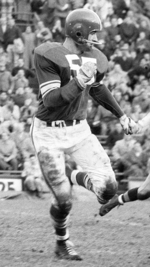 Dan Currie led the 1957 Spartans to a No. 3 national ranking as an All-American center offensively and defensive leader at linebacker.