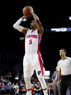 Feb 15, 2017; Auburn Hills, MI, USA; Detroit Pistons guard Kentavious Caldwell-Pope attempts a shot against the Dallas Mavericks during the second quarter at the Palace.