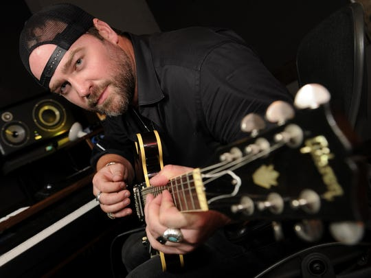 Country star Lee Brice in his home studio.