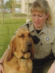 Coby Webb is photographed with her bloodhound, Maggie Mae around the time that Maggie was deputized in 2001.