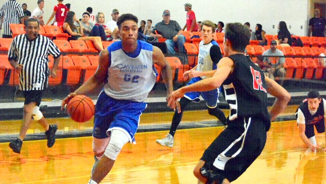 Carlsbad's Chris Johnson cuts inside toward the basket in a summer league game against Portales Friday at Artesia.