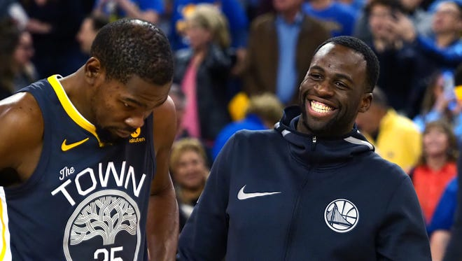 Feb 12, 2018: Golden State Warriors forward Kevin Durant (35) and forward Draymond Green (23) react before being presented their all-star jerseys before a game against the Phoenix Suns at Oracle Arena.