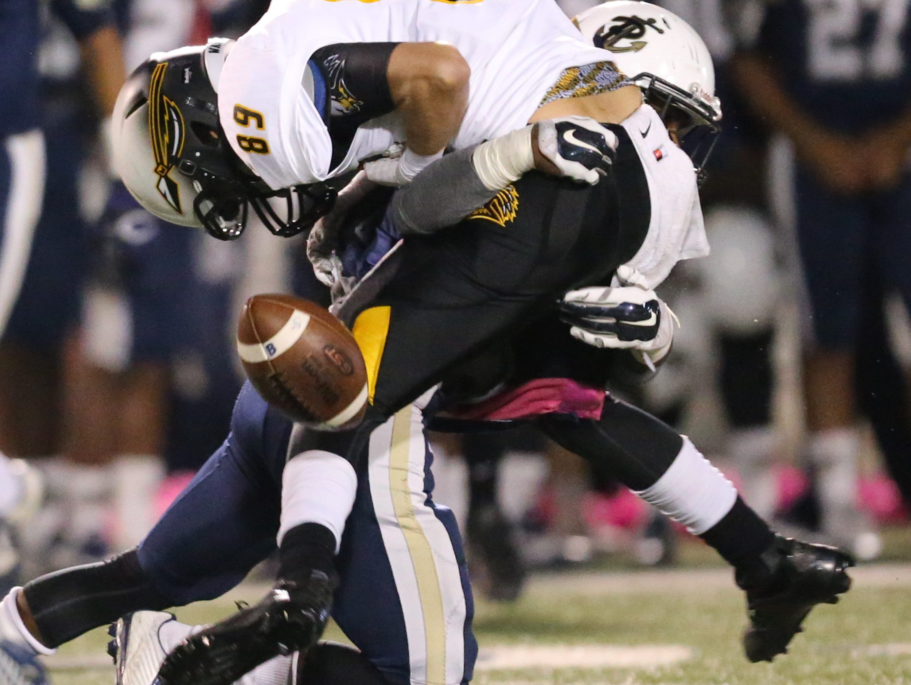 Pearl forces a fumble late in the second quarter. Oak Grove and Pearl played in a high school football game on Friday, October 30, 2015 at Pearl High School. Photo by Keith Warren (Mandatory Photo Credit)