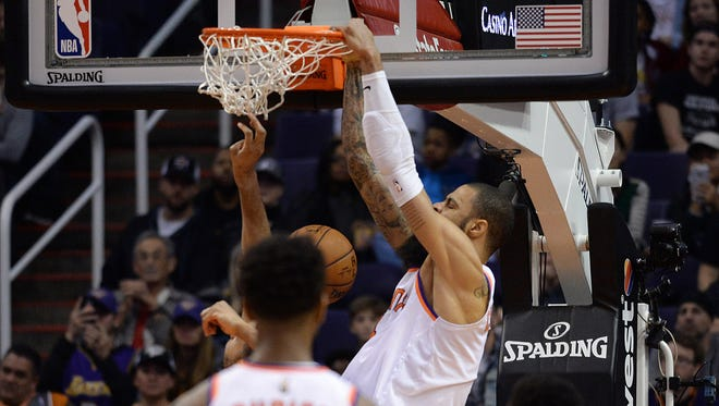 Dec 26, 2017: Phoenix Suns center Tyson Chandler (4) makes the go ahead basket against the Memphis Grizzlies during the second half at Talking Stick Resort Arena.