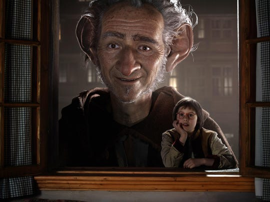 """Ruby Barnhill as Sophie (right) with the Big Friendly Giant, voiced by Mark Rylance in Steven Spielberg's """"The BFG."""""""