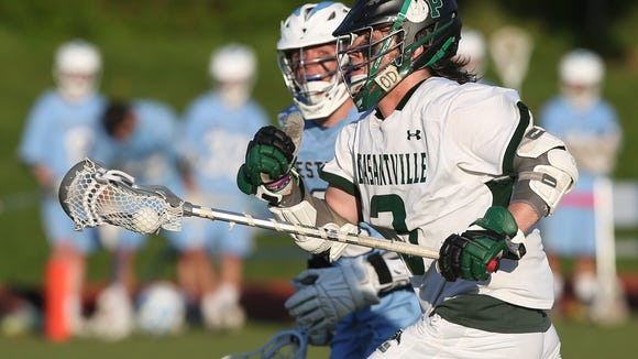 Pleasantville's Declan McDermott (3) races past  Westlake's Nicholas Colabaistto (13) during boys lacrosse action at Pleasantville High School May 9, 2018. Pleasantville won the game 13-6.
