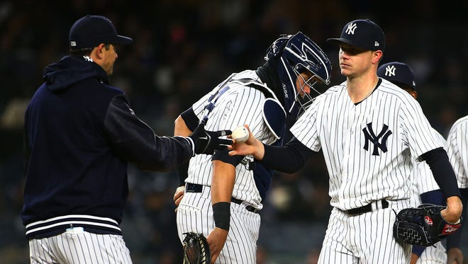 Apr 20, 2018; Bronx, NY, USA; New York Yankees starting pitcher Sonny Gray (55) is taken out of the game by New York Yankees manager Aaron Boone (17) against the Toronto Blue Jays during the fourth inning at Yankee Stadium.