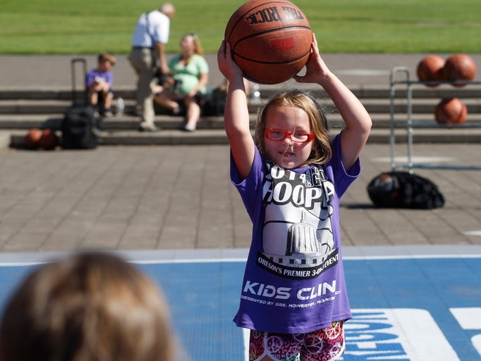 Lillian Gandara, 6, takes part in a passing drill during the Hoopla Kids Clinic on the Capitol Mall on Thursday, July 31, 2014.