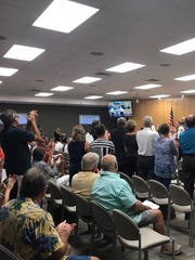 Mary Husted receives a standing ovation during the
