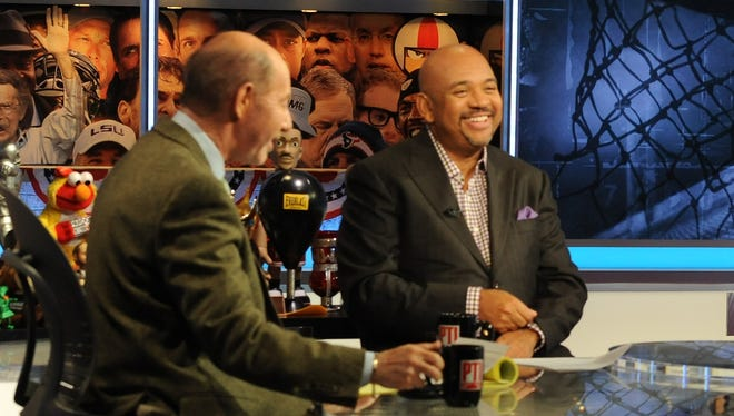 'Pardon the Interruption' co-hosts Tony Kornheiser, left, and Michael Wilbon signed a contract extension with ESPN.