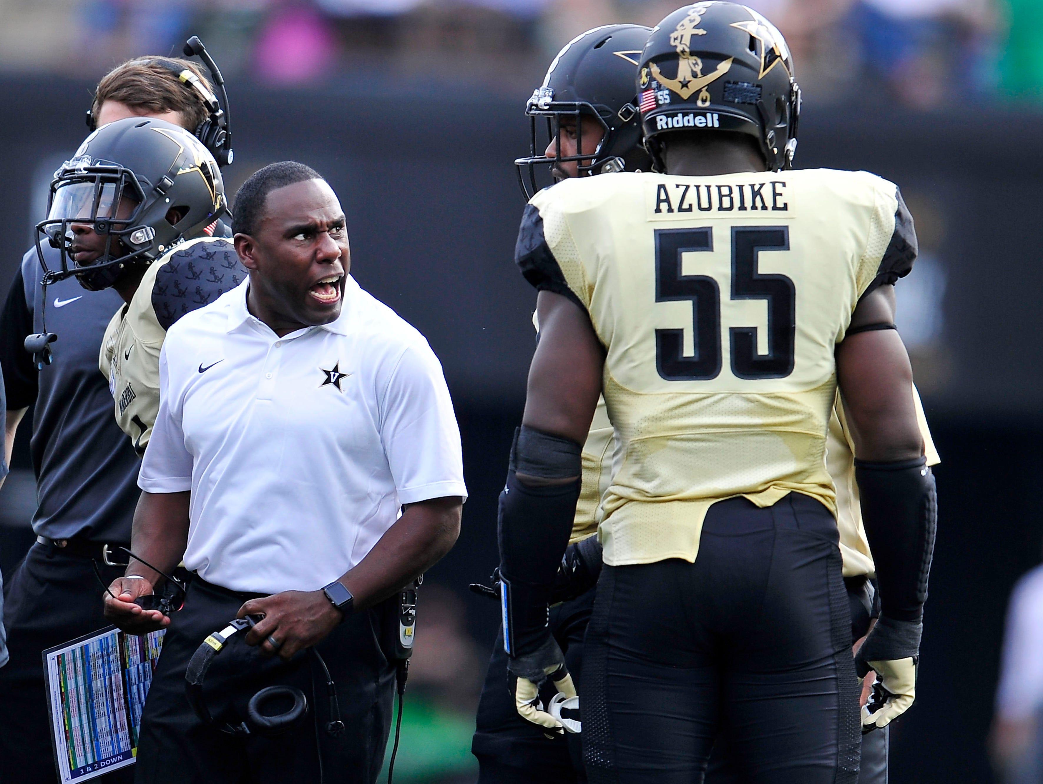 Vanderbilt coach Derek Mason, left, defensive end Caleb Azubike (55) and the Commodores will face MTSU on Saturday.