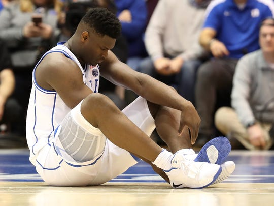 DURHAM, NORTH CAROLINA - FEBRUARY 20: Zion Williamson #1 of the Duke Blue Devils reacts after falling as his shoe breaks against Luke Maye #32 of the North Carolina Tar Heels during their game at Cameron Indoor Stadium on February 20, 2019 in Durham, North Carolina. (Photo by Streeter Lecka/Getty Images) ORG XMIT: 775243270 ORIG FILE ID: 1131053027