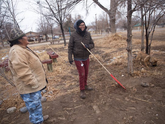 From left, Volunteers LaVonna George and Trini King work Sunday at the Healing Circle Drop-In Center's garden area in Shiprock.