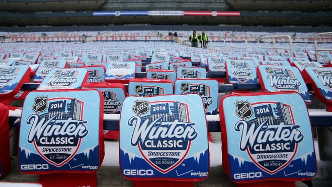 A general view of seat cushions placed int he stands during practice the day before the Winter Classic hockey game between the Detroit Red Wings and the Toronto Maple Leafs at Michigan Stadium.