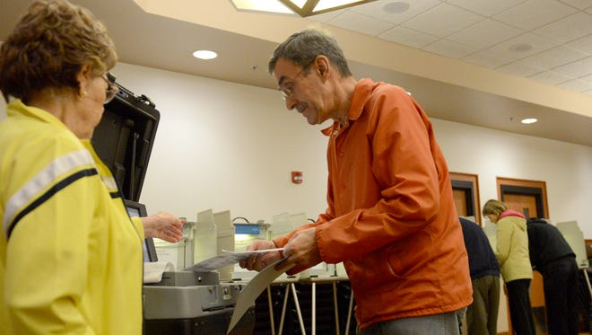 Christopher Wilde votes at the Allouez Village Hall, Tuesday, November 4, 2014.