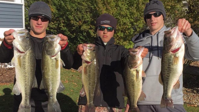 From left, Jake Patton, Zach McNary, and Tanner Oppenhuis are getting better fishing thanks to aeration of Indian Lake in Cass County.