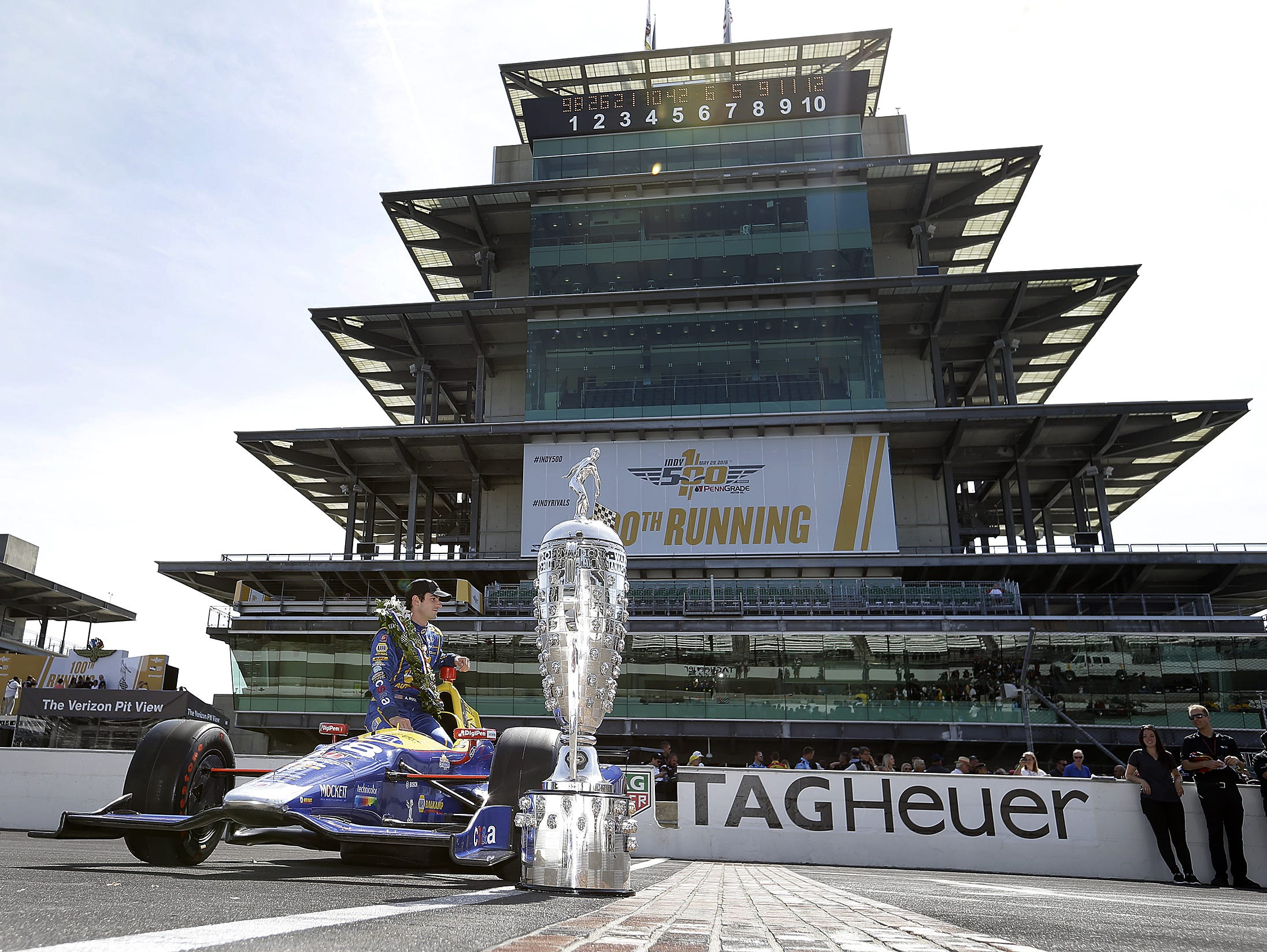 IndyCar driver Alexander Rossi (98) poses for photos following his win in the 100th running of the Indianapolis 500 Monday, May 30, 2016, morning at the Indianapolis Motor Speedway.
