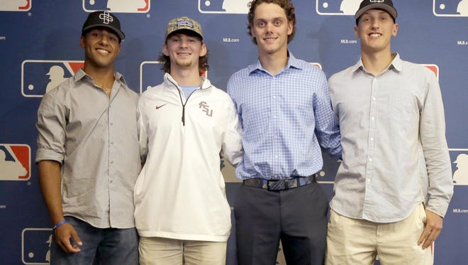 Amateur baseball players, from left, Garrett Whitley, Brendan Rodgers, Ashe Russell and Mike Nikorak pose for a photo after a media luncheon for Major League Baseball's Draft, Monday, June 8, 2015, in New York. (AP Photo/Mary Altaffer)