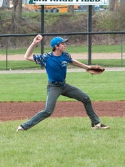 Danbury's Sam Tyson throws the ball to first base during