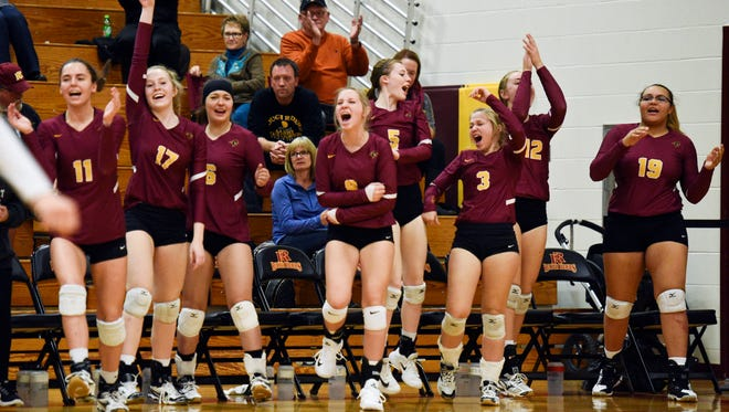 Roosevelt's bench erupts in celebration after winning the their high school volleyball match against Lincoln on Tuesday, Oct. 24, 2017.