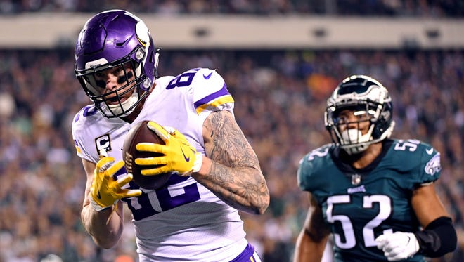 Minnesota Vikings tight end Kyle Rudolph catches a touchdown pass against Philadelphia Eagles outside linebacker Najee Goode during the first quarter in the NFC Championship Game.