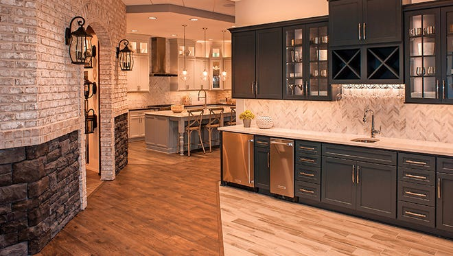 From the entry, the Drees Design Center impresses with several samplings of cabinets, exterior lighting and stone as well as flooring.