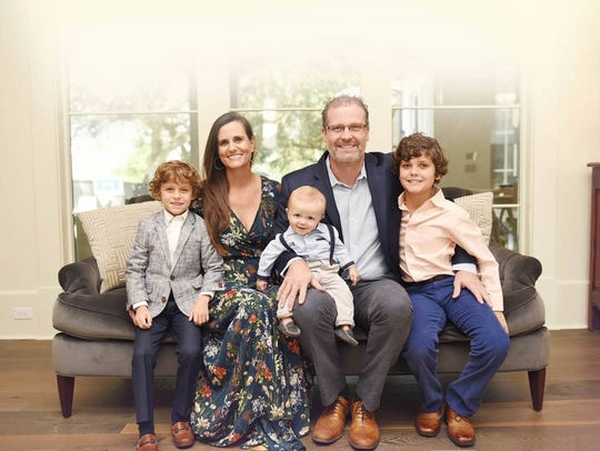 Dr. Barrios with wife, Christin, and their three sons.