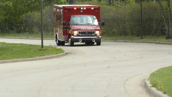 A Portage County ambulance makes its way down a driveway. The town of Grant is suing the county for taxing its residents to fund a county-wide ambulance service the town does not want or use.