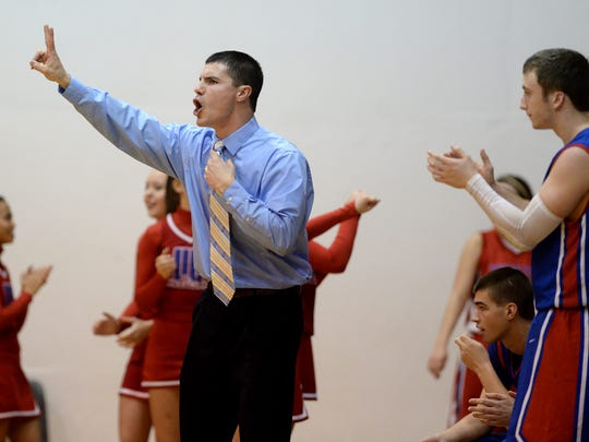 Union City boys basketball coach Dustin Baldwin watches game action Hagerstown during a basketball game Friday, Jan. 29, 2016, at Hagerstown High School. Baldwin was recently hired to coach Winchester after taking a year off from high school coaching.