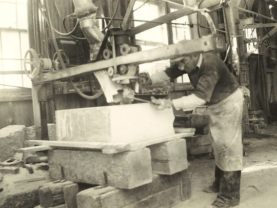 A stonecutter works on the Mark Twain monument at the Emanuel Settimelli & Sons yard in Quincy, Mass., in 1937.